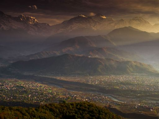 Sunrise view over Pokhara where the Himalayas create a spectacular backdrop.