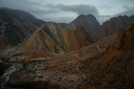 Orange hills surrounding the town of Min Kush, Kyrgyzstan