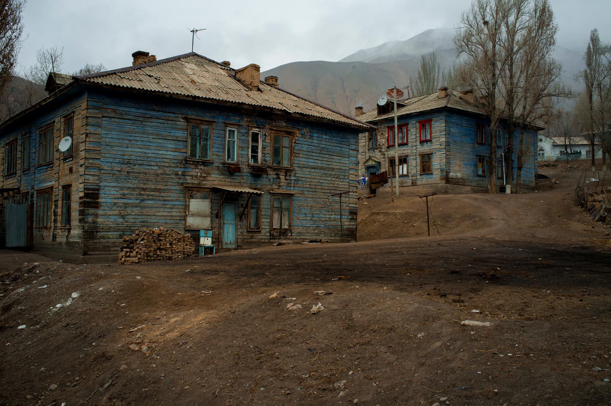 Blue wooden houses in Min Kush, Kyrgyzstan