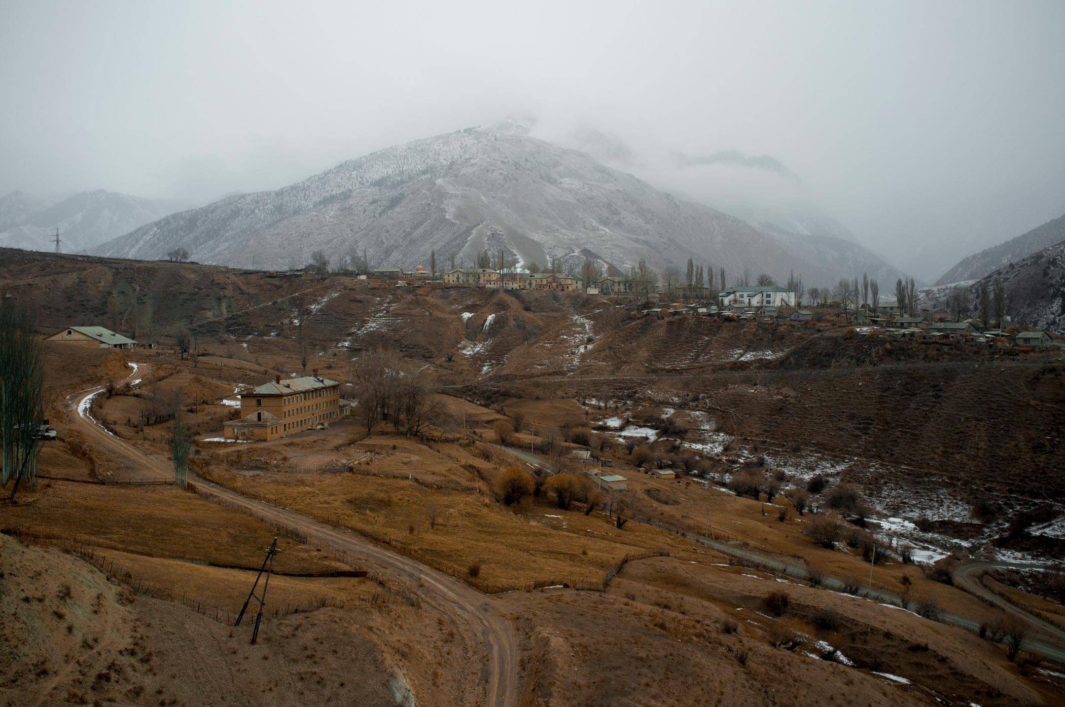 Brown fields overlooking Min Kush in Kyrgyzstan