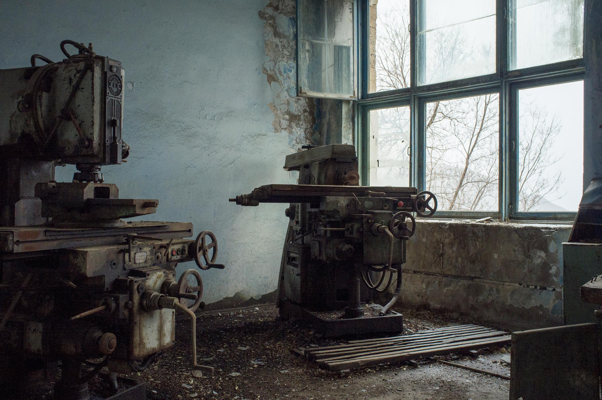 Machinery in a derelict pen factory in Min Kush, Kyrgyzstan