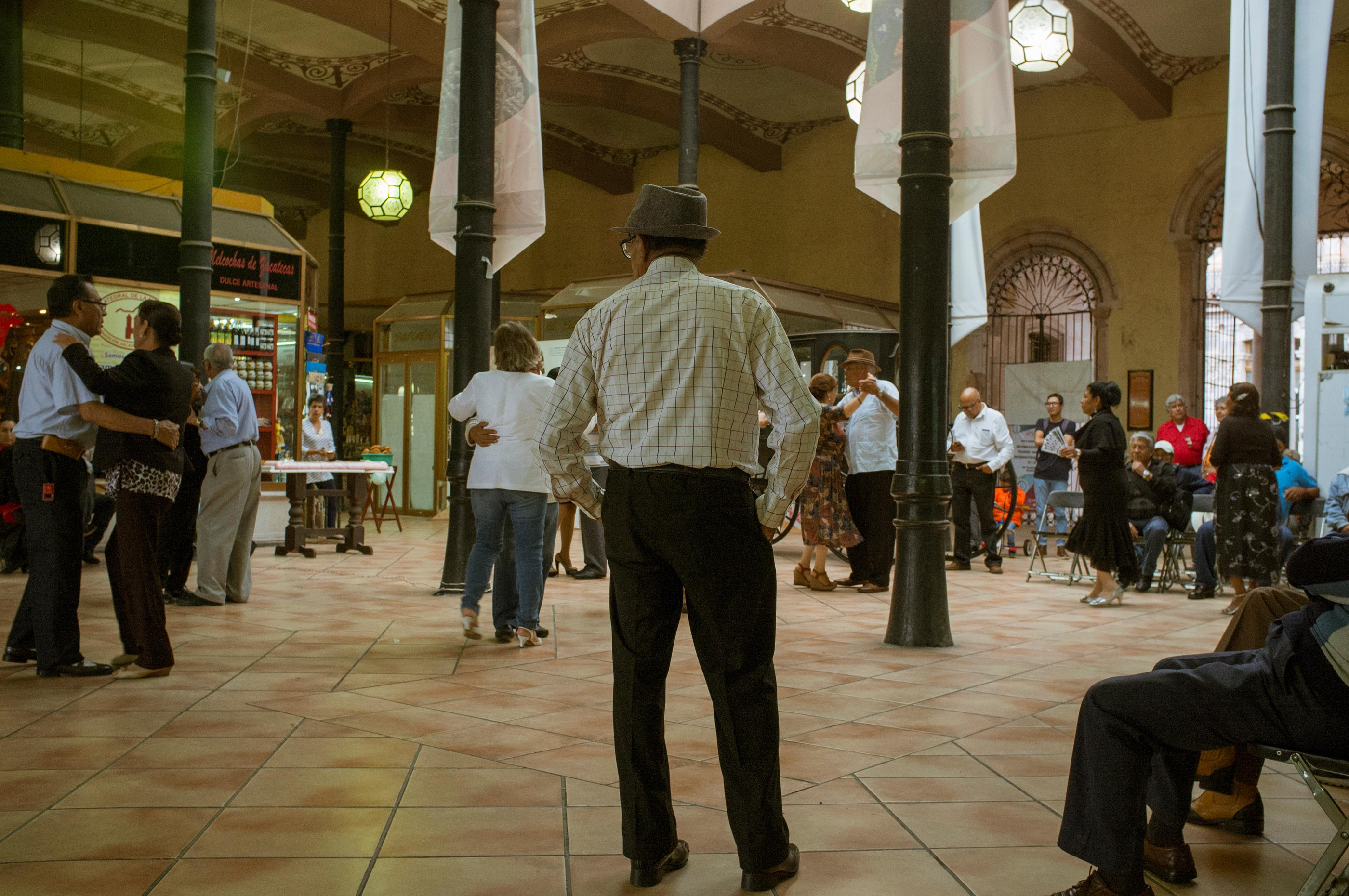 People dancing under the arches in a market in Zacatecas.