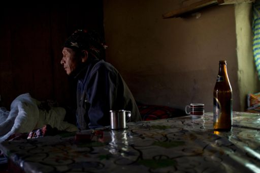 A man sits in a cafe in Landruk, Nepal.