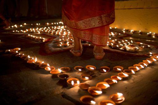 Candles being lit to celebrate the Maha Shivaratri Festival in Varanasi.