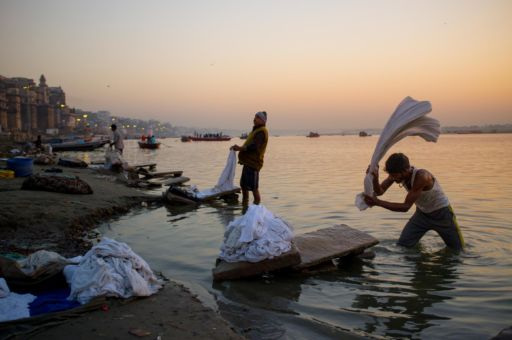 Dhobis (washer people) doing laundry on the ghats of Varanasi.