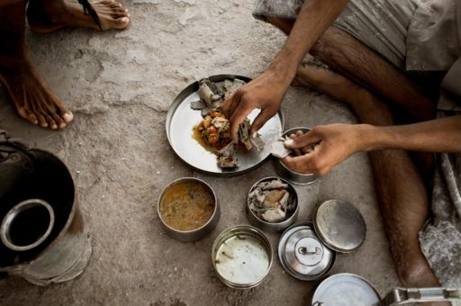 Salt workers in Rajasthan eat a simple lunch of vegetable curry and chapatis.