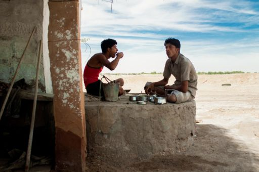 Salt workers in Rajasthan eat a simple lunch of vegetables and chapatis.