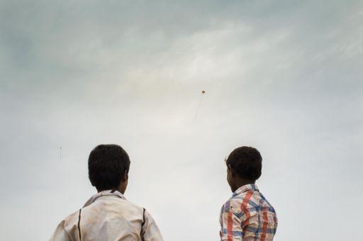 Children fly a kite over a salt pan in Tuticorin, Tamil Nadu.