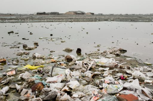 Salt pans in Tuticorin filled with rubbish during the rainy season.