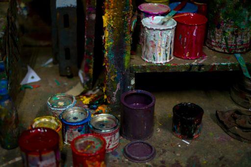 Paint pots in a rickshaw artist's workshop.