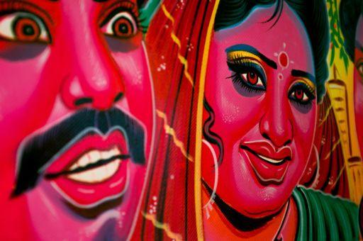 An acid pink illustration of movie stars on a rickshaw panel.