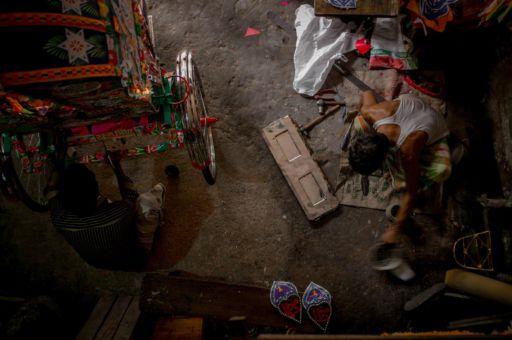 Overhead shot of a rickshaw workshop in Bangaldesh.