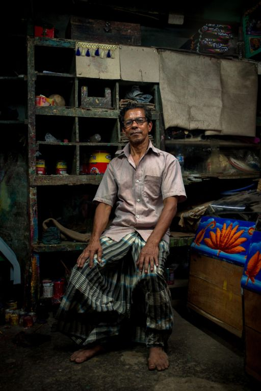 Bonjo, a rickshaw artist, in his studio in Chittagong.