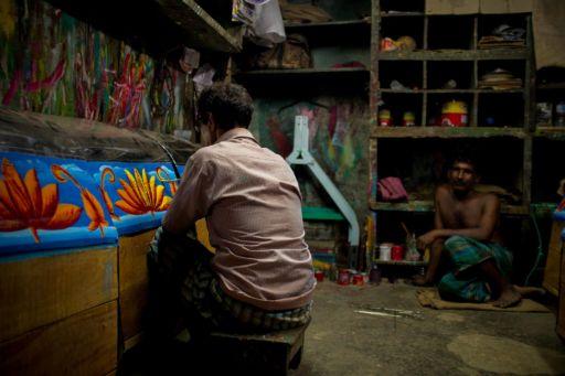 A rickshaw artist at work in his studio in Chittagong.