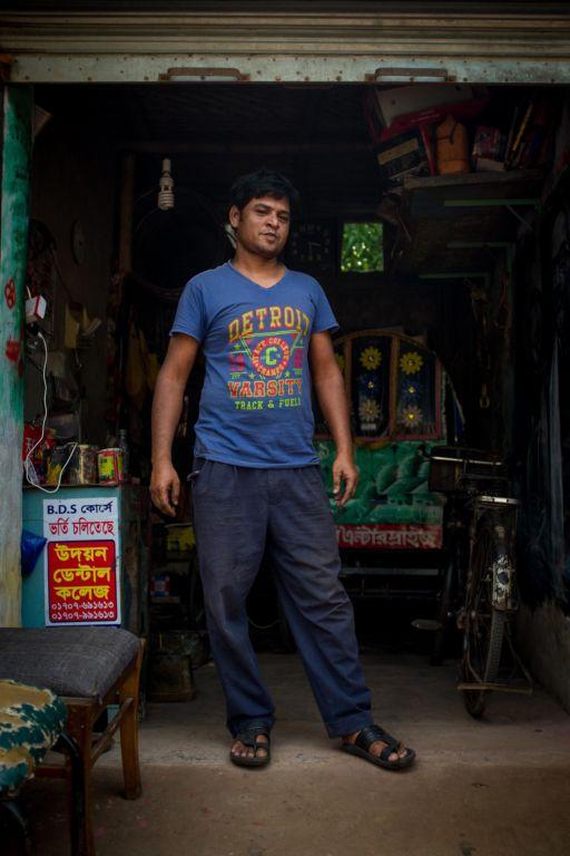 A former rickshaw artist stands outside his workshop in Rajshahi.