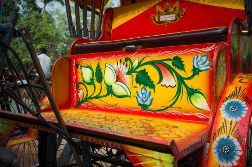 Floral detailing on a rickshaw seat.
