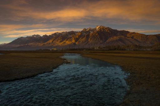 View across grasslands and mountains in Tashkurgan, Xinjiang, China.