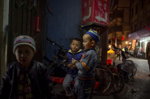 Three boys playing on the streets of Kashgar