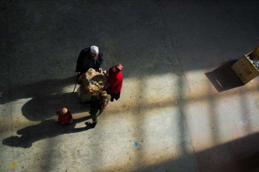 A woman sells eggs to customers in Hotan, Xinjiang.