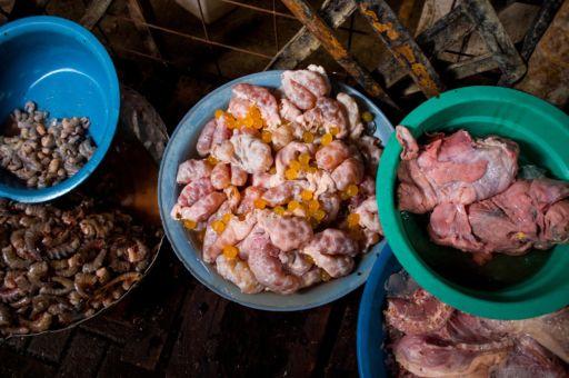 Basins of fish eggs and seafood in the Galeria Pueblo Nuevo market in Buenaventura, Colombia.