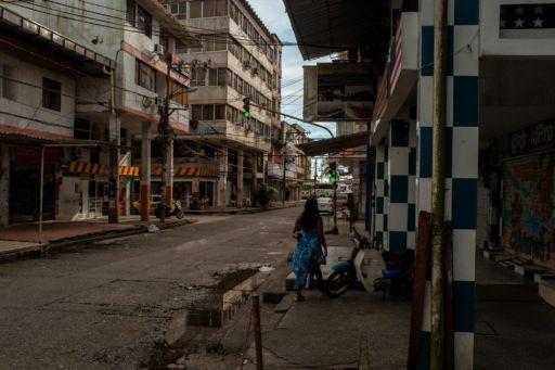 A woman walks down a street in Buenaventura, Colombia.
