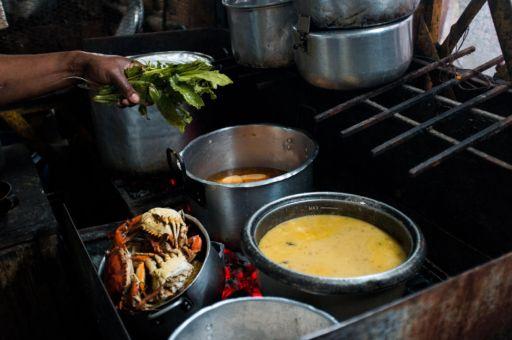 Cooking pots on a coal burning stove in Buenaventura's Galeria Pueblo Nuevo Market