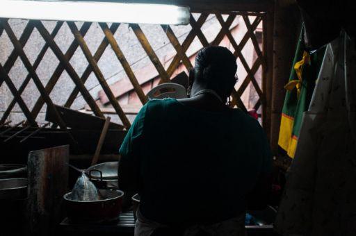 A woman cooking in a market kitchen in the Galeria Pueblo Nuevo market in Buenaventura, Colombia.