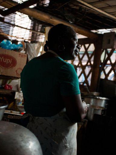 A woman works in a market kitchen in the Galeria Pueblo Nuevo market, Buenaventura, Colombia
