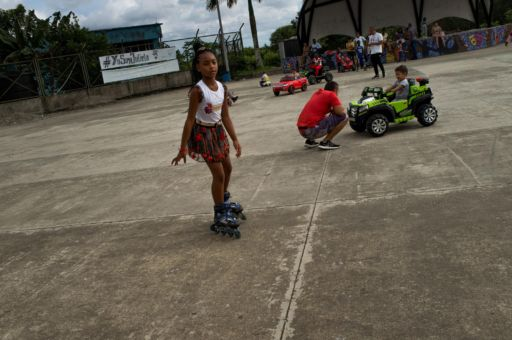 A young girls skates on rollerblades at the seafront in Buenaventura, Colombia