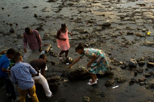 Children play on the beach at low tide