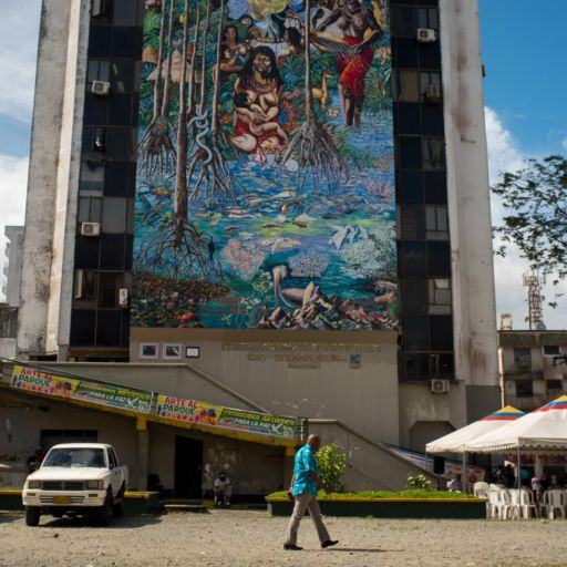 A large mural on the outside wall of an administrative building in Buenaventura, Colombia